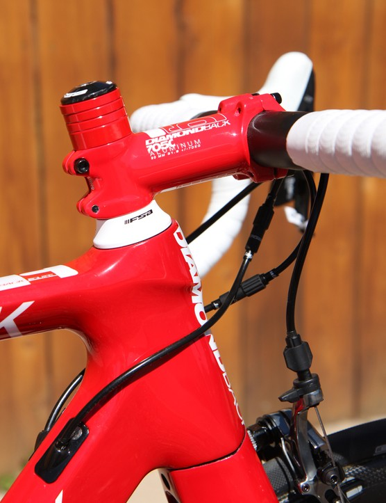 Diamondback ambitiously goes for a bold, nearly monochrome red color scheme on the Podium Equipe – but the various parts don't all match