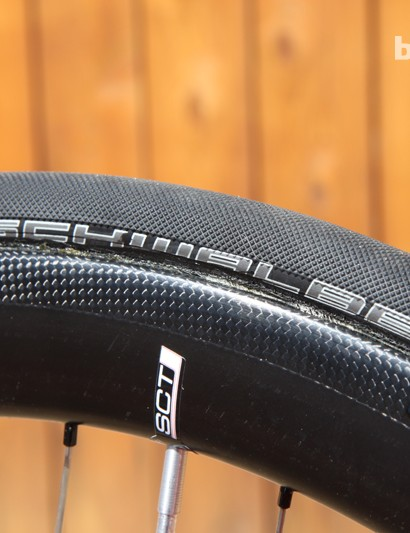 The Schwalbe Ultremo HT Race Guard tubulars have a fine pattern to help improve grip in wet weather and on dusty surfaces, while the puncture resistant belt should help ward off flat tires
