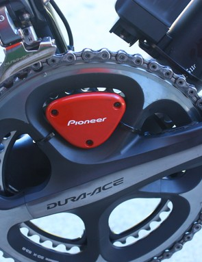 The Pioneer Pedaling Monitor: Strain gages are used on the inside of each crank arm, and this red piece is the ANT+ transmiter
