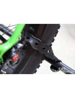 The rear wheels are held in place with rubberized straps, long enough to carry a fat bike