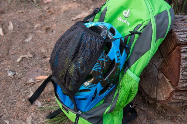 The Deuter Race EXP Air features a store-away helmet holder - this could also be used to carry body armour