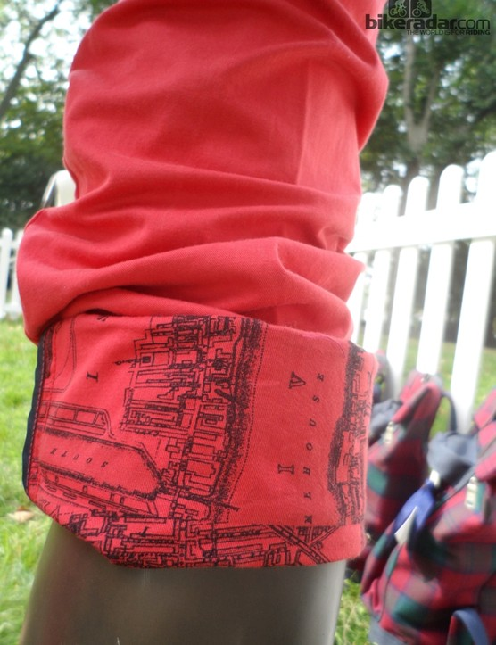 The bold red riding trousers feature a London map print on the inside of the leg