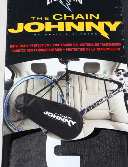This is a Chain Johnny, which lets you transport your bike inside the back seat of a car while keeping the greasy drivetrain covered
