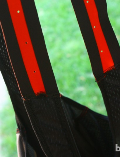 Capo Drago bib short: A 'harness' is used at the top of the bib straps