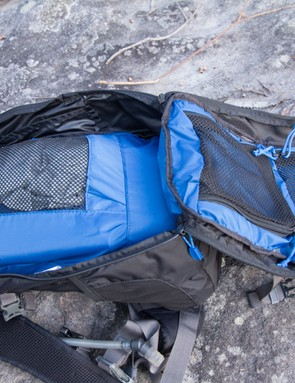 The Dakine AMP 18L opens wide for access to the many compartments
