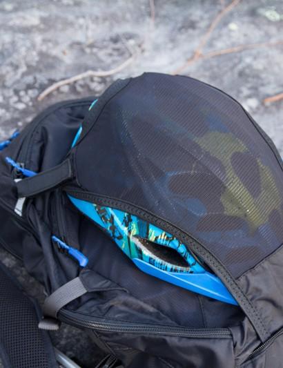 The Dakine AMP 18L features a stash away helmet holder
