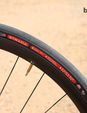 Challenge labels its Strada open tubular tires as being 25mm wide but they actually measure 27mm across when mounted on these wider rims. Especially when paired with latex tubes, the ride quality and traction that results is ungodly good. Rolling resistance doesn't noticeably suffer at all, either.
