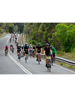 Riders descend through the scenery of the Royal National Park