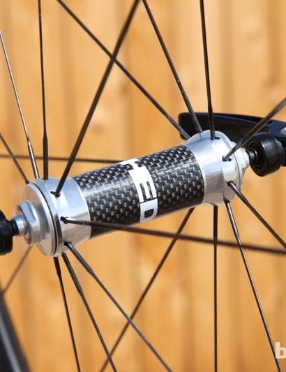 The HED Ardennes Plus SL front hub features a carbon center sleeve and straight-pull flanges pre-slotted for bladed spokes