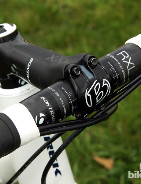 The all-carbon cockpit includes a Bontrager RXXXL stem and RXL IsoZone handlebar. Note how the faceplate is sealed with silicone glue