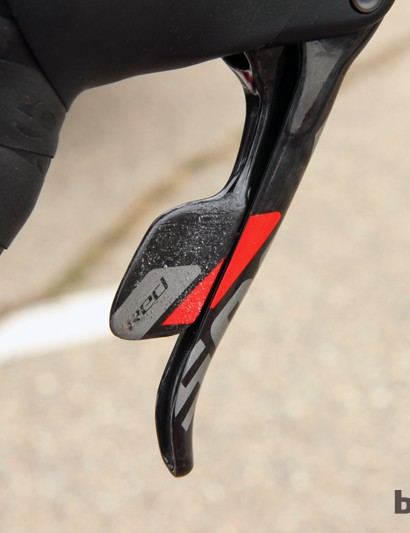 Mark Legg-Compton adds extra grip to Katie Compton's SRAM Red 22 Hydro shift levers with a little bit of glue and sand