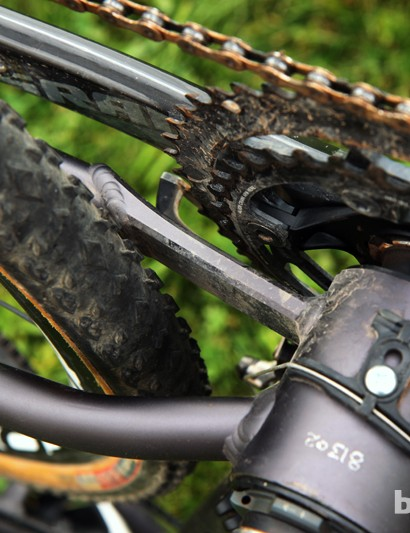 Van Dessel boosts tire and chainring clearance on the Aloominator by using this short CNC machined piece on the driveside chain stay