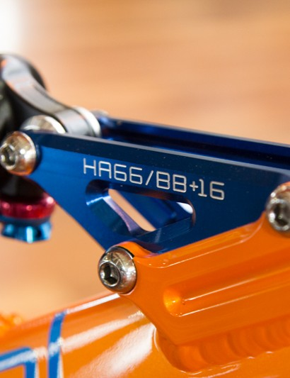 Changeable linkage plates allow for geometry, travel and even wheel size adjustments