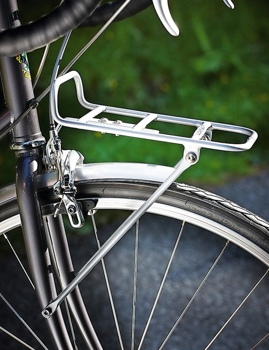 The front rack is not designed for masses of luggage, but you can bungee a backpack to it to save wearing it and it'll take a small pack of beer quite neatly