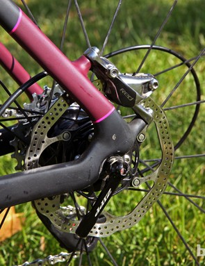 While many companies prefer to tuck the rear disc caliper inside the rear triangle, Specialized goes with a more conventional spot behind the seat stay