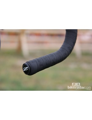 Zipp's textured handle bar tape helps Trebon keep his grip in wet and muddy conditions