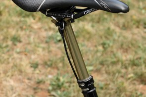 A Fox DOSS dropper seatpost is topped by a Bontrager Evoke RXL saddle with molded carbon fiber rails