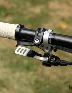 Fox received heavy criticism for its bulky DOSS dropper seatpost remote but when placed underneath the bar, it actually works extremely well