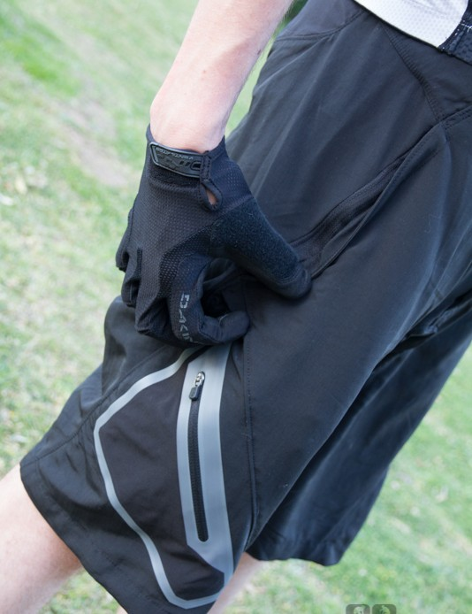 The Dakine Boundary shorts feature zippered side pockets with reinforced bottoms