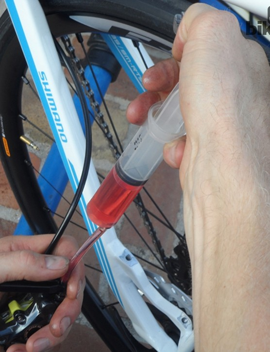 Marcus, Shimano's mechanic, prefers to remove the calliper from the frame to inject the fluid. He says it just makes things easier