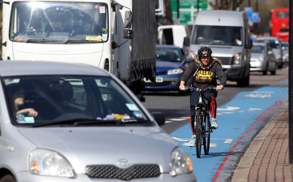 Johnson says cyclists will continue to have to share roads with vehicles because there isn't enough seperate space for cycling