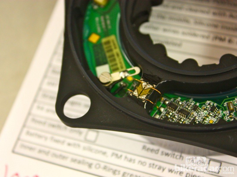 SRM power meters use spider-mounted strain gages that are attached with copper wires to a circuit board below