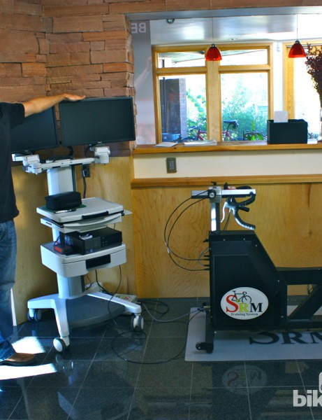 SRM prides itself on its lab-quality equipment. Here, Mike Hall stands next to a lab system that includes an ergometer, software and hardware plus storage room for a metabolic cart suite