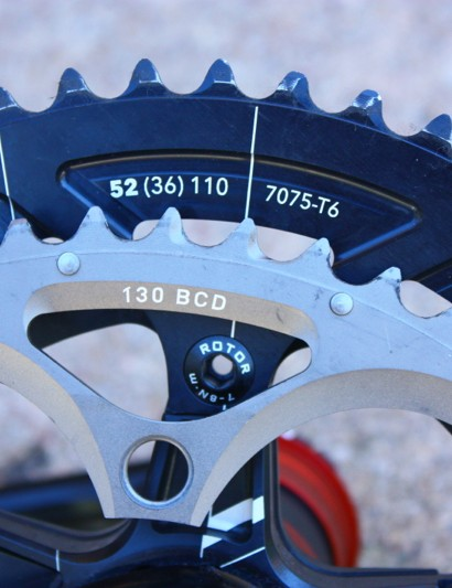 The key number for compatiblilty is BCD (Bolt Circle Diameter) - the diameter of the circle that intersects the center of all five chainring bolts. A compact is 110mm, while a standard is 130mm