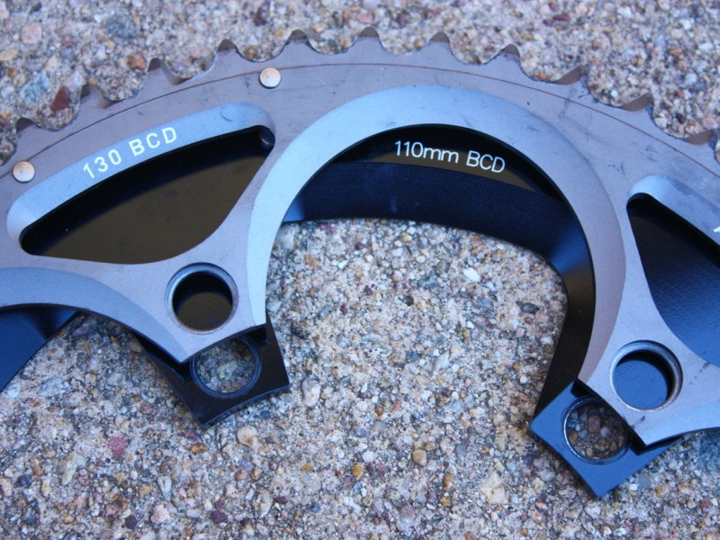 A compact crank has a 110mm BCD and thus a smaller range of chainrings. A standard crank has a 130mm BCD and bigger chainrings