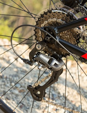 The Shimano Acera rear derailleur worked fine, but it didn't hold the chain as firmly as more expensive units
