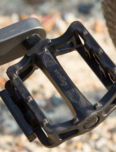 The basic plastic pedals won't do much off-road, best to factor in the price of some better pedals