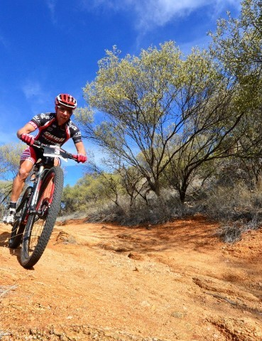 Elite rider Shaun Lewis racing in the perfect blue skies of Alice Springs