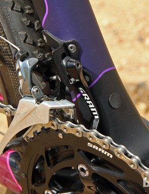 The SRAM Force 22 front derailleur is backed up by a built-in chain catcher. Note the plugged hole for use with electronic drivetrains