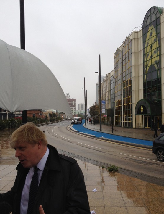 Boris Johnson unveils the first fully segregated Cycle Superhighway route with a Virgin Media van parked in the lane