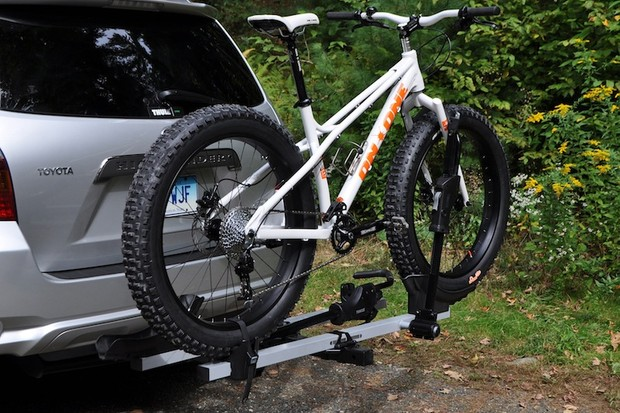 Thule has an upgrade kit for its popular T2 rack that allows it to carry fat bikes by their massive tires