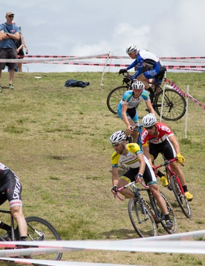 The elite men's battle it out on the hilly grass course at the Rapha SuperCross