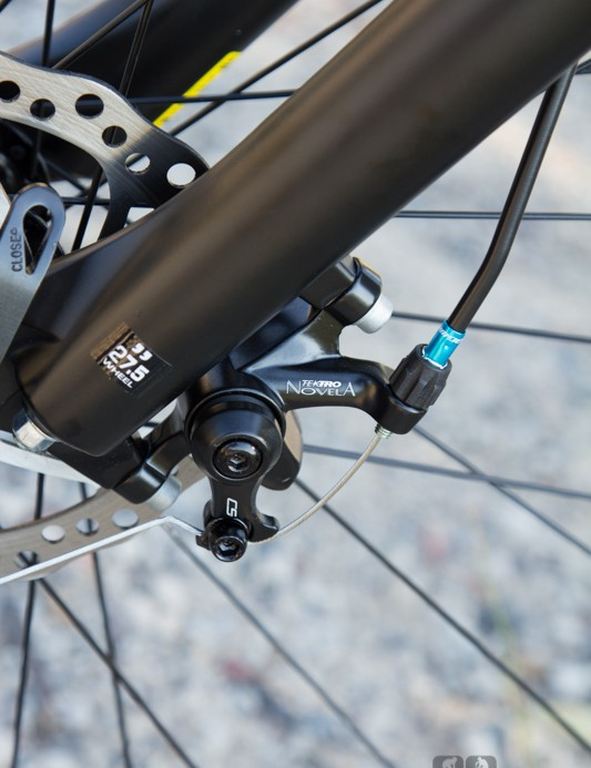 The Switch 27.3 uses basic Tektro mechanical disc brakes - they work but lack the power and bite of a hydraulic brake