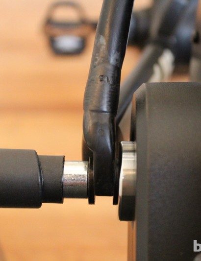 CycleOps Silencer: The dropout engagement is rock solid. And unlike a standard trainer, you don't have to worry about scuffing up a quick release or swapping it out for another one. (Since you're looking at it - the carbon repair was done by www.brokencarbon.com)