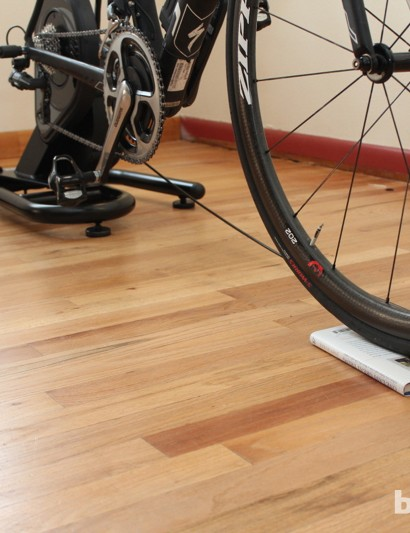 CycleOps Silencer: There is a slight differential (~1.5cm) between the rear height and the front. We fixed it with a small book