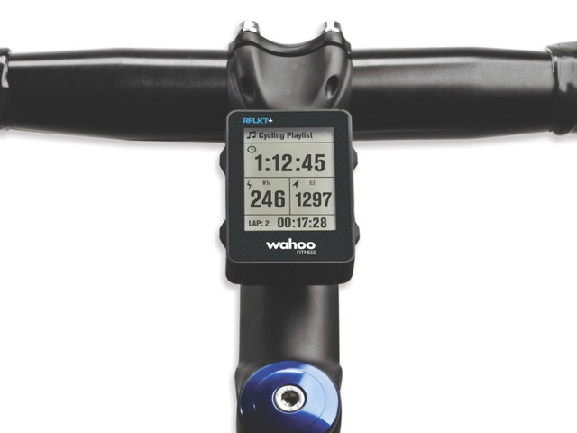The RFLKT+ from Wahoo Fitness displays the data from cycilng apps on the handlebar, while the iPhone stays in a jersey pocket