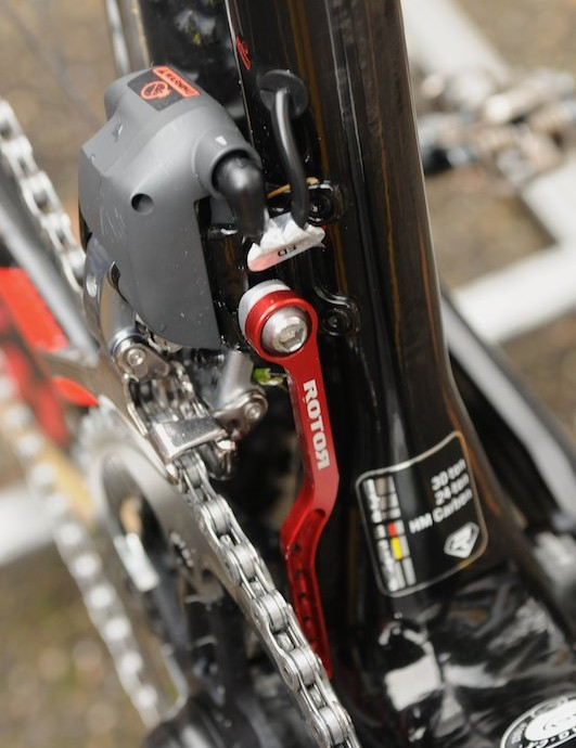A Rotor chain keeper is bolted to the front of the Shimano Dura-Ace Di2 front derailleur