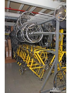 A fleet of trademark yellow Mavic neutral support bikes lie in wait for their next assignment