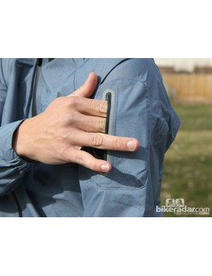 A small zippered pocket on the upper arm of the Giro New Road Waterproof Jacket is perfectly sized for your phone or wallet