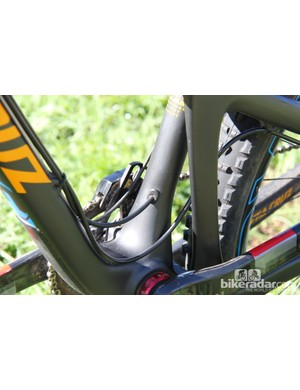 The line for the RockShox Stealth Reverb seatpost is routed through a small port in the seat tube
