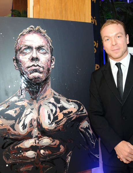 Sir Chris Hoy with exclusive painting by Paul Oz, sold in the charity auction
