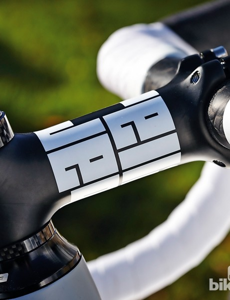 The carbon stem and handlebar are from the distributor's own brand, Barelli