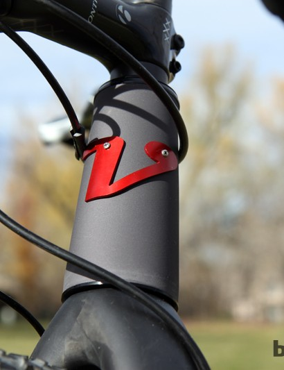 The simple bolted-on head tube badge is a nice touch