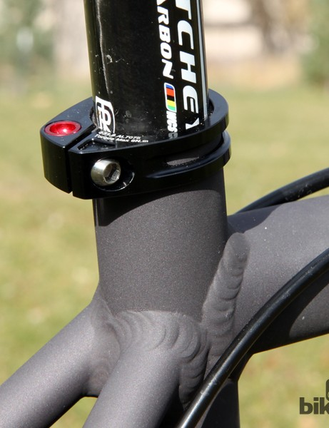 The included seatpost collar includes a rotating barrel nut to maintain proper bolt alignment