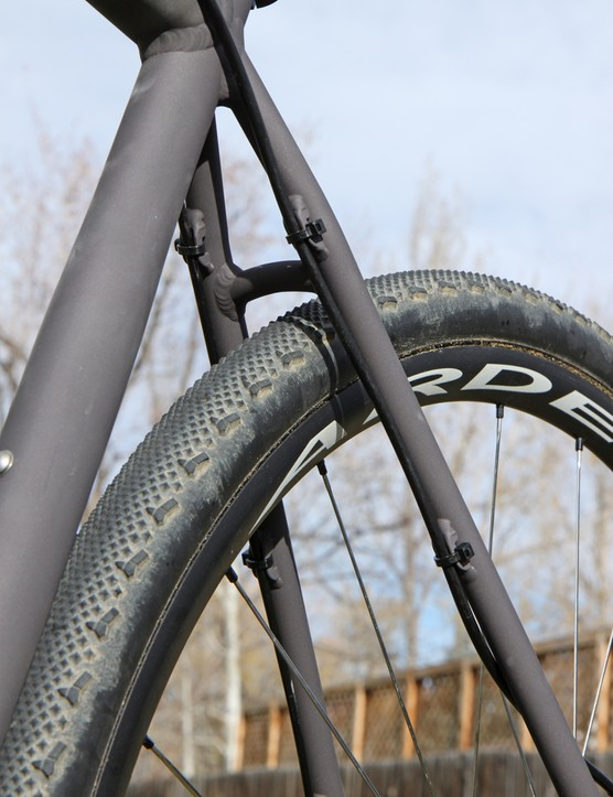 The rear derailleur housing and rear brake hose are attached to the front of the stays with zip-ties