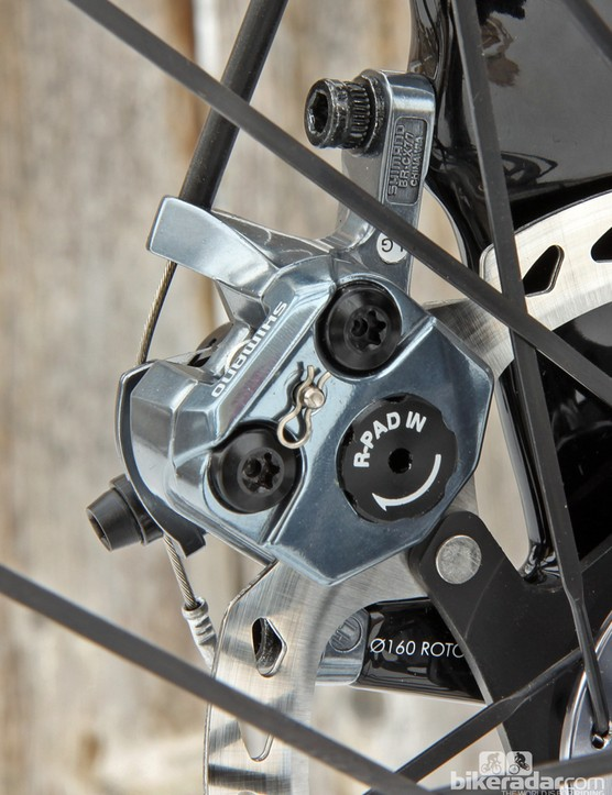 Shimano says the BR-CX77 has Independently adjustable pads for easier setup but only the inboard adjustment is detented